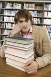 Bored College Student At Library Desk Royalty Free Stock Photo