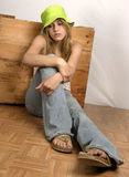 Bored but cool. Studio shot of teen posed against wooden crate, with bored look Stock Photography