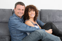 Bored couple sitting on the couch Royalty Free Stock Photo
