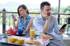 Bored couple using smartphone Stock Photo