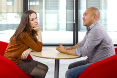 Bored Date. Interracial date that is boring and un-romantic royalty free stock photography