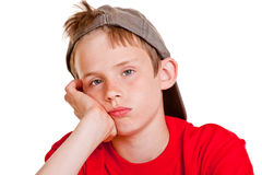 Bored depressed young boy with sad eyes Stock Photos