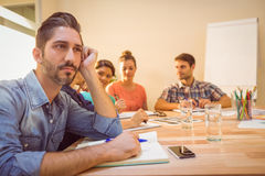 A bored designer during a meeting Royalty Free Stock Image