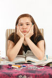 Bored of doing Homework. Young girl bored of doing her homework Stock Photography