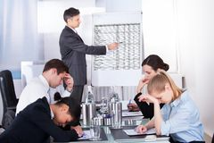 Bored employees in business meeting. Bored Businesspeople At Presentation With Colleagues In Office Stock Images
