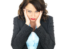 Bored Fed Up Young Business Woman. A DSLR royalty free image, of an attractive young business woman, holding head in her hands in frustration, looking unhappy Royalty Free Stock Image