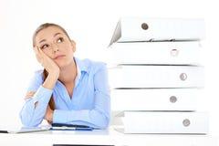 Bored female employee on white background Stock Photography