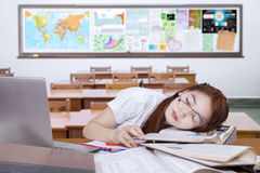 Bored female learner sleeping in the class Stock Photo