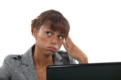 Bored female office worker Stock Photo