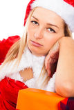 Bored female Santa waiting for Christmas Royalty Free Stock Images