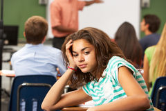 Bored Female Teenage Pupil In Classroom Stock Photo