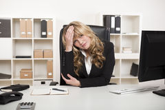 Bored friendly young businesswoman Royalty Free Stock Images
