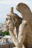 Bored Gargoyle of Notre Dame III. Stock Image