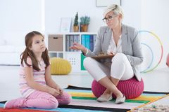 Bored girl attending therapy session Royalty Free Stock Photos