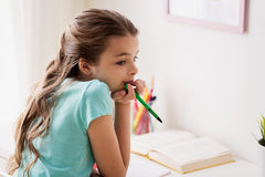 Bored girl with book and pen at home Royalty Free Stock Images