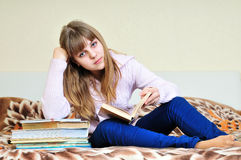 Bored girl with books royalty free stock photography