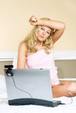 Bored girl communicating using a web camera Royalty Free Stock Photos