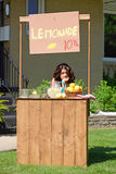 Bored girl at lemonade stand Royalty Free Stock Images