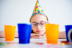 Bored girl on a party. A teen girl is bored and sad on a birthday party Stock Image