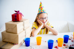 Bored girl on a party. A teen girl is bored and sad on a birthday party Royalty Free Stock Photos