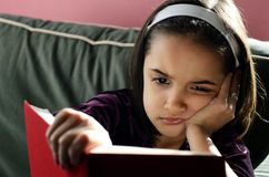 Bored Girl Reading Stock Images