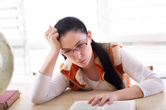 Bored girl reading book Royalty Free Stock Image