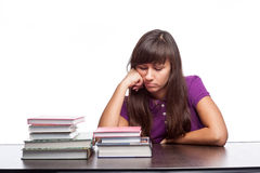 Bored girl sitting with books Stock Photography