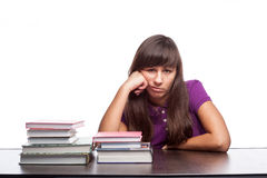 Bored girl sitting with books Royalty Free Stock Photo