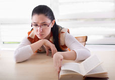 Bored girl stopped reading book Royalty Free Stock Image