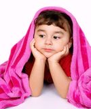 Bored girl under pink blanket royalty free stock images