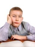 Bored Kid doing Homework Stock Images