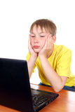 Bored Kid with Laptop Stock Images