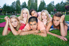 Bored Kids on the Grass Royalty Free Stock Photos