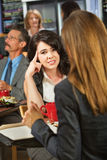 Bored Lady in Cafe. Bored women with coworker in coffee house Stock Photos