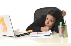 Bored latin businesswoman working tired at office computer desk looking exhausted Royalty Free Stock Image