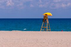 Free Bored Lifeguard Alone On The Beach, No Vacationers Stock Photo - 192215490