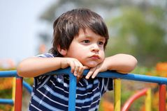 Bored little boy. On the playground Stock Image