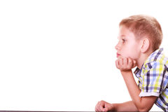 Bored little boy sit alone at table. Stock Image