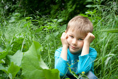 Bored little boy on walk Royalty Free Stock Photos