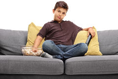 Bored little boy watching TV Stock Image