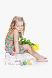 Bored little girl with Easter decorations Stock Photography