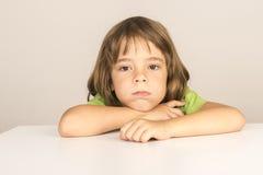 Bored little girl Stock Photo