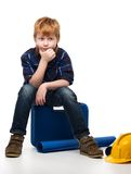 Bored little mechanic boy Royalty Free Stock Photo