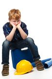 Bored little mechanic boy Royalty Free Stock Photos