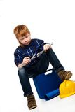 Bored little mechanic boy Stock Photos