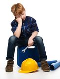 Bored little mechanic boy Royalty Free Stock Images