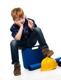 Bored little mechanic boy Stock Photography