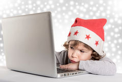 Bored little Santa Stock Image