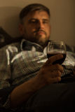 Bored lonely guy with wine Royalty Free Stock Image