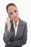 Bored looking bank employee on her cellphone Stock Images